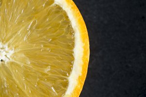 Orange slice on black background