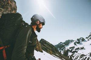 Man adventurer climbing