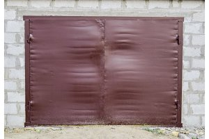 Iron gates on the garage. Brown gates made of steel
