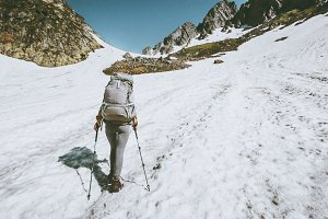 Alpinist woman with backpack