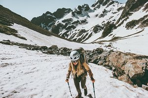 Active woman climbing in snowy