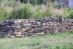 An old ruined wall made of rubble.