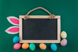 Easter composition with blackboard