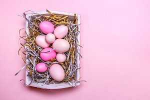 Pink eggs in a white tray