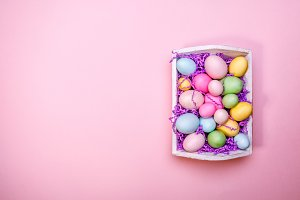 White tray with colourful eggs