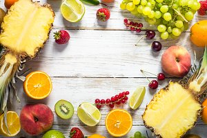 Fruit and berries over white wooden table. Top view.