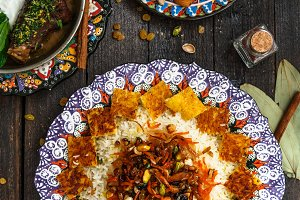 Jewelled rice with lamb and fruits, top view