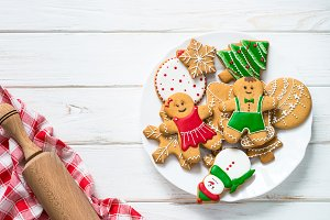 Christmas gingerbread on white table top view.