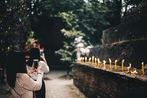 Asian tourists are using the phone to take photos of the ancient city of Chiang Mai, Thailand.