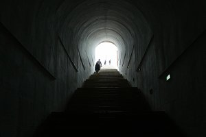 dark tunnel with the silhouette people