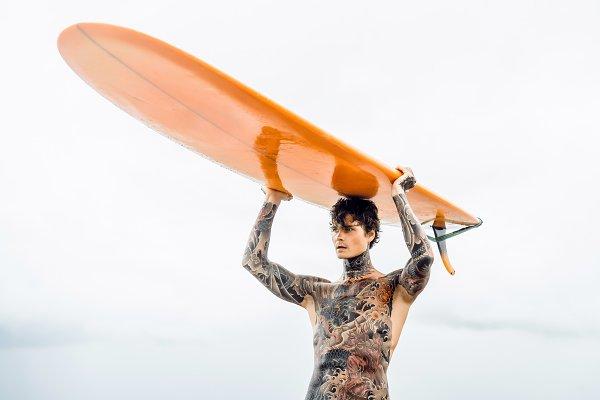 Sports Stock Photos: EVA  -  surfing and tattoo