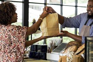 Black customer buying bakery product