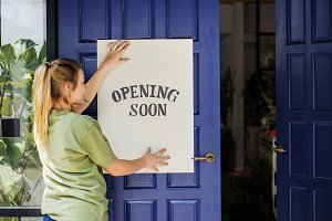 Women putting on store opening soon