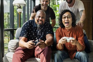Friends enjoying video game together