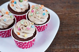 Chocolate cupcakes decorated with cr