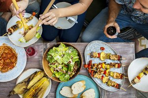 Diverse people eating food together