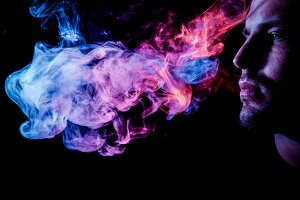 Man and colorful smoke