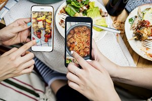 People sharing food photos on mobile