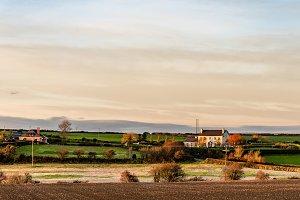 Scenic view of Irish farmland at sunset