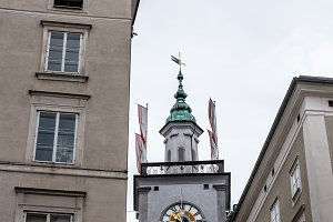 Low angle view of clock tower in Salzburg