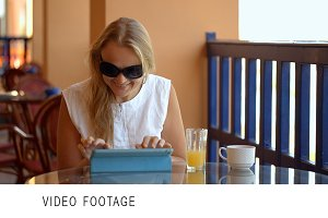 Woman in cafe with tablet PC