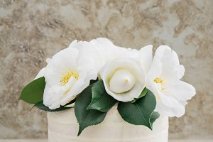 Naked wedding cake with camellias