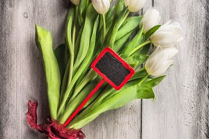 Tulips bouquet with red sign