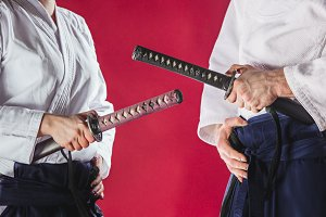 The two men are training Aikido at studio