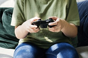 Woman playing video game alone