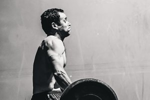 Crossfit Man Lifting Clean