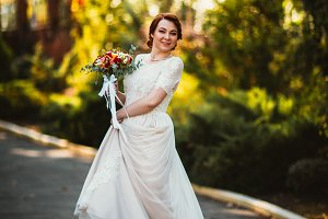 Bride on a background of trees in th