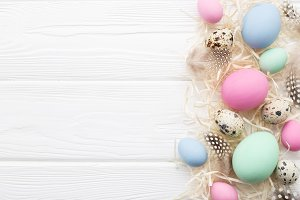 Easter frame of pastel colored eggs