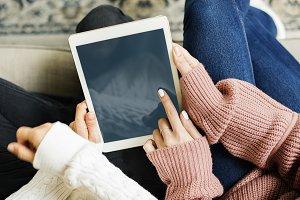 Women using digital tablet (PSD)