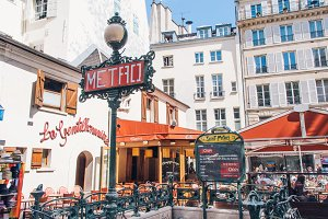 Paris Metro Sign and Cafe