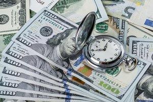 Clock and dollar bills