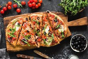 Flatbread pizza with fresh arugula