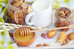 Honey, almonds and jar with milk