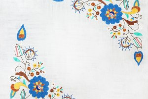 embroidered flowers on a white backg