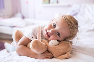 Cute little girl with her teddy bear