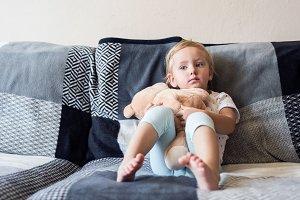 Cute little girl with her teddy bear