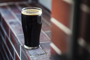 Pint of stout on bricks