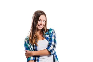Smiling young girl in blue checked shirt, isolated