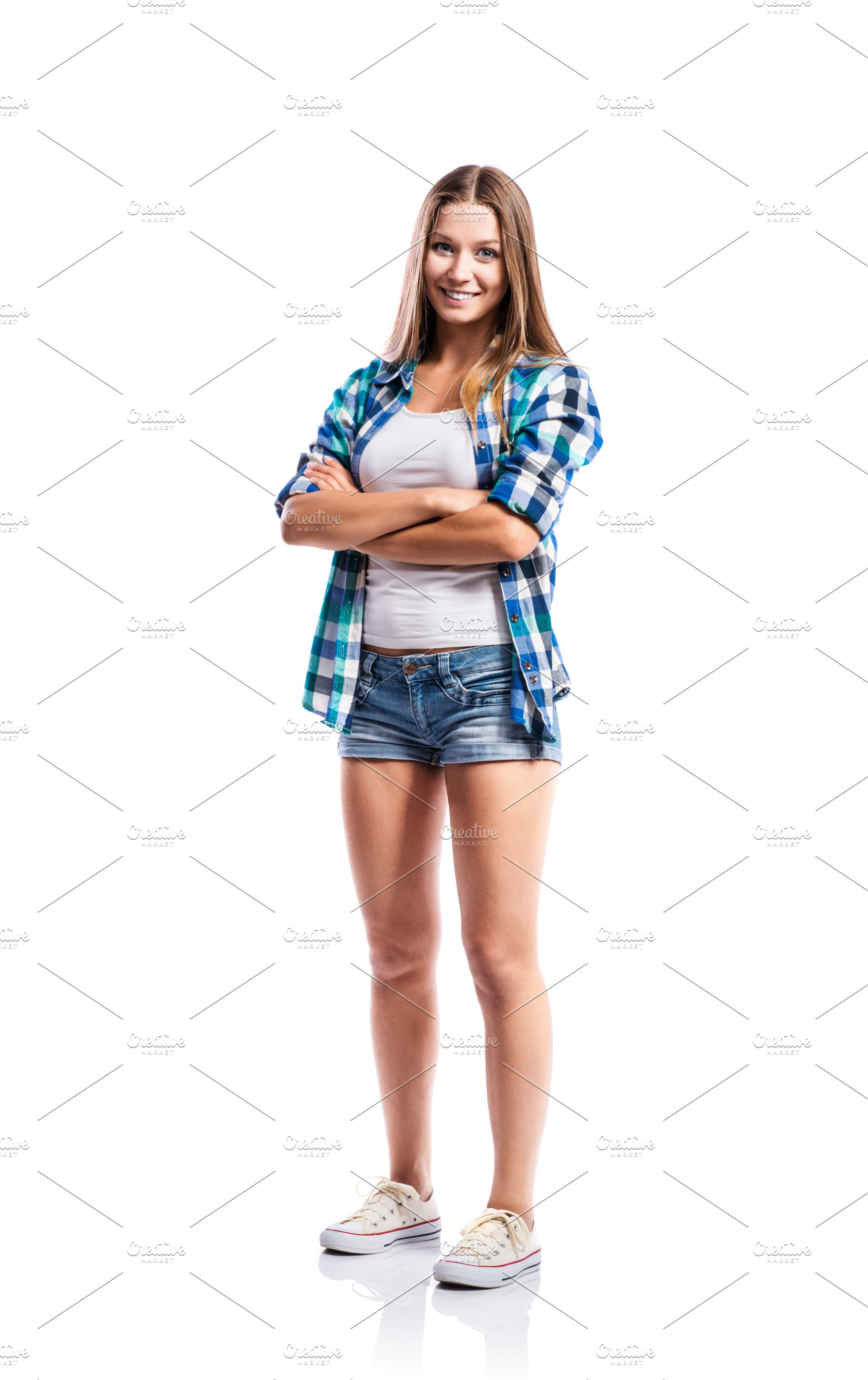 Girl In Shorts And Checked Shirt Arms Crossed Isolated