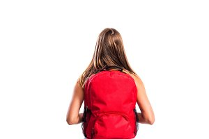 Beautiful student with schoolbag. Studio shot on white backgroun