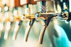 Beer craft. Bar table. Steel taps. Shiny taps.