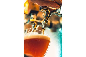 Beer craft. Bar table. Steel taps. Shiny taps. Glassses with beer