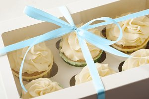 sweet present. gift box with cupcakes