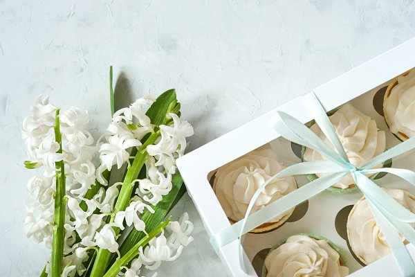 Holiday Stock Photos - Gift box and white flowers on rustic table for March 8, International Womens day, Birthday or Mothers day, beautiful spring card