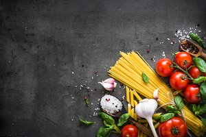 Italian Food background on black stone table. Top view.