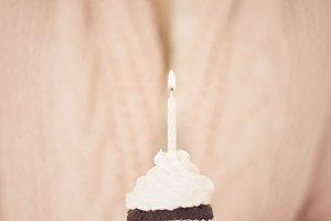 Beautiful woman holding a cupcake